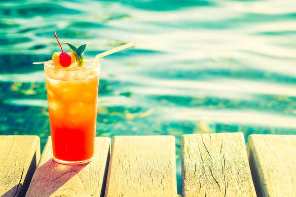 glass of fresh juice on the dock