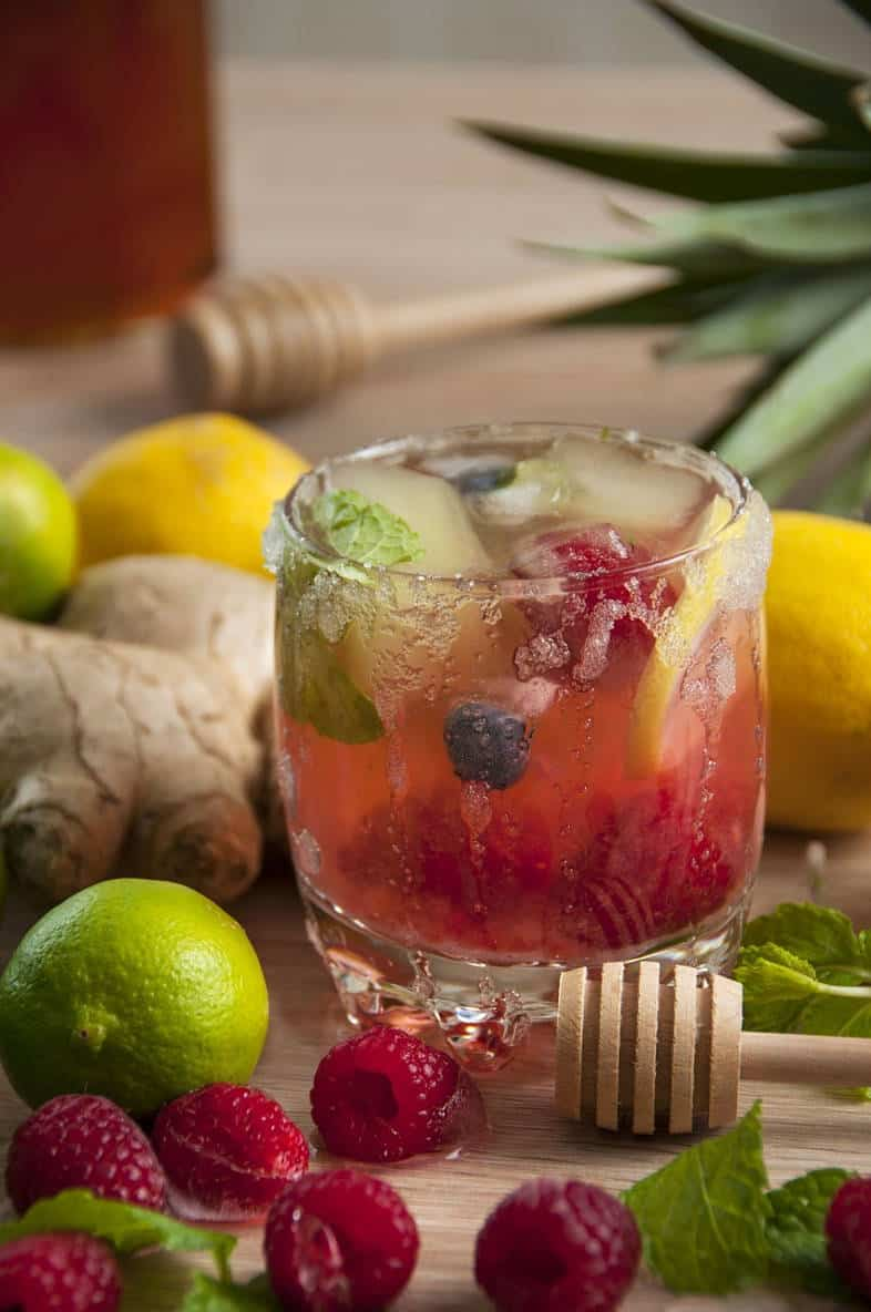 water with ginger, lemon, and berries