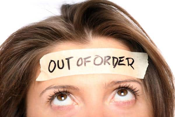 woman with out of order sticker on head - meditation for anxiety and depression