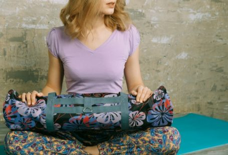 woman holding yoga mat bag