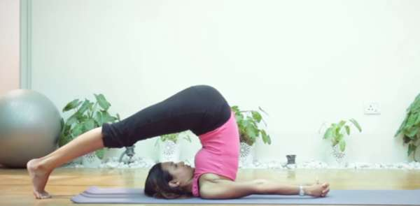 woman in plow pose