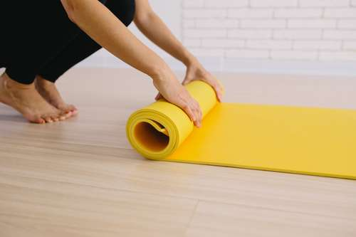 rolling up a pilates mat for easy storage