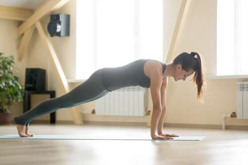 woman doing standard plank pose