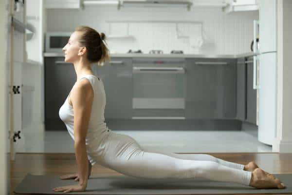 woman in upward facing dog pose