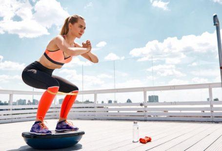 best cheap bosu ball - woman squatting on bosu ball