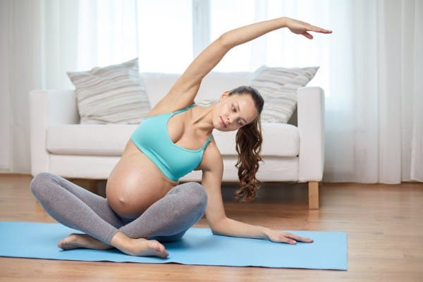 pregnant woman practicing prenatal yoga