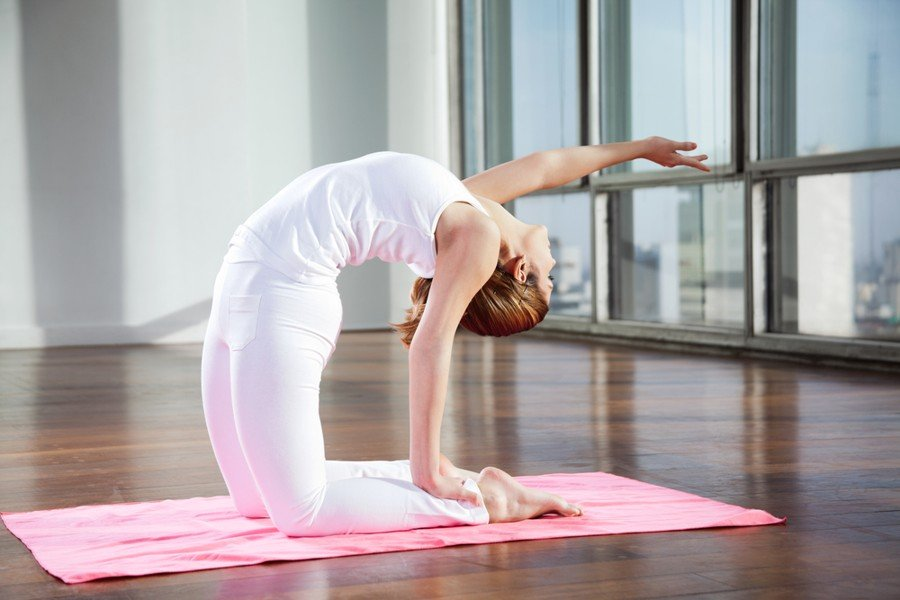 best non toxic yoga mats - woman doing back bend on yoga mat
