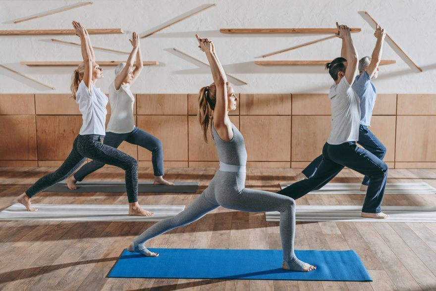 easy yoga poses for beginners - group of people practicing yoga