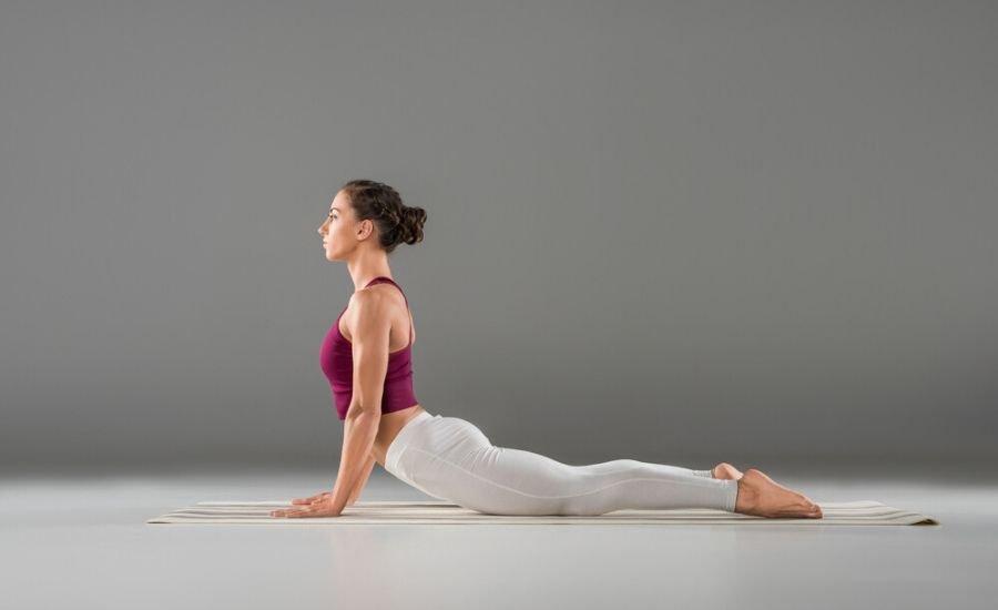 woman doing cobra pose