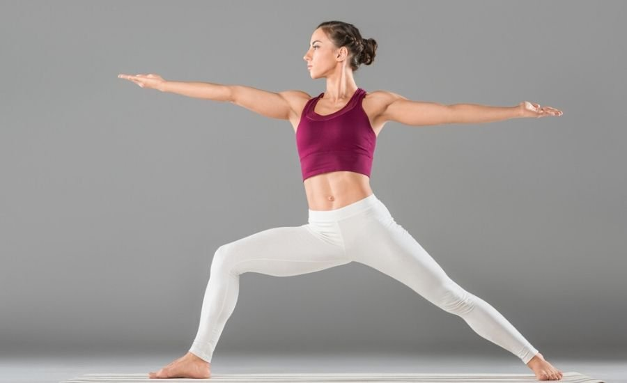 woman doing warrior two pose