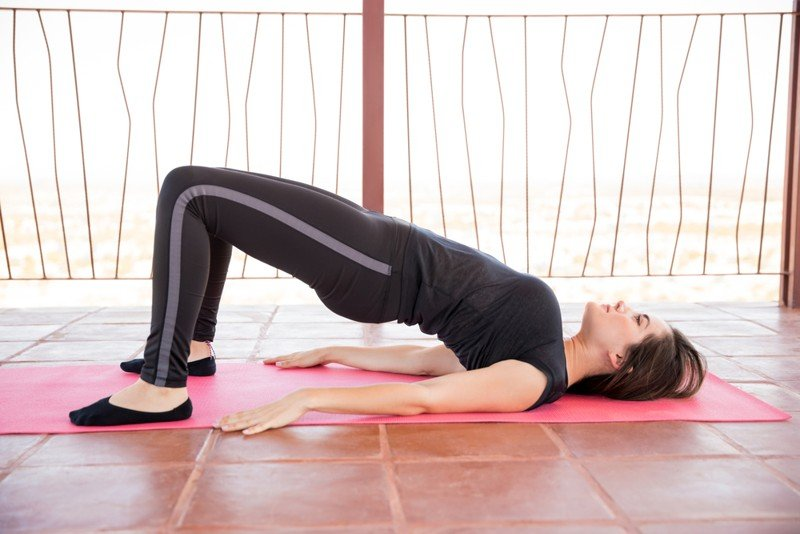 woman performing bridge pose for relaxation