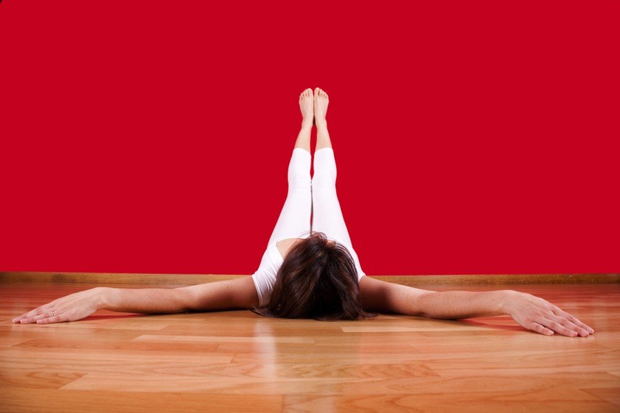 woman doing legs up the wall pose
