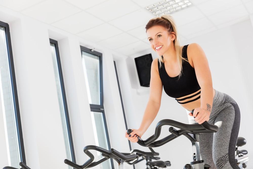 woman using folding exercise bike