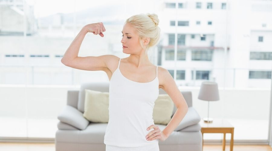 fit young woman flexing her arms