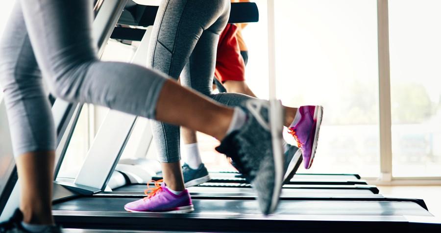 several people running on treadmills