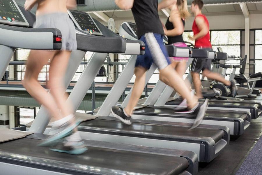 group running on treadmills