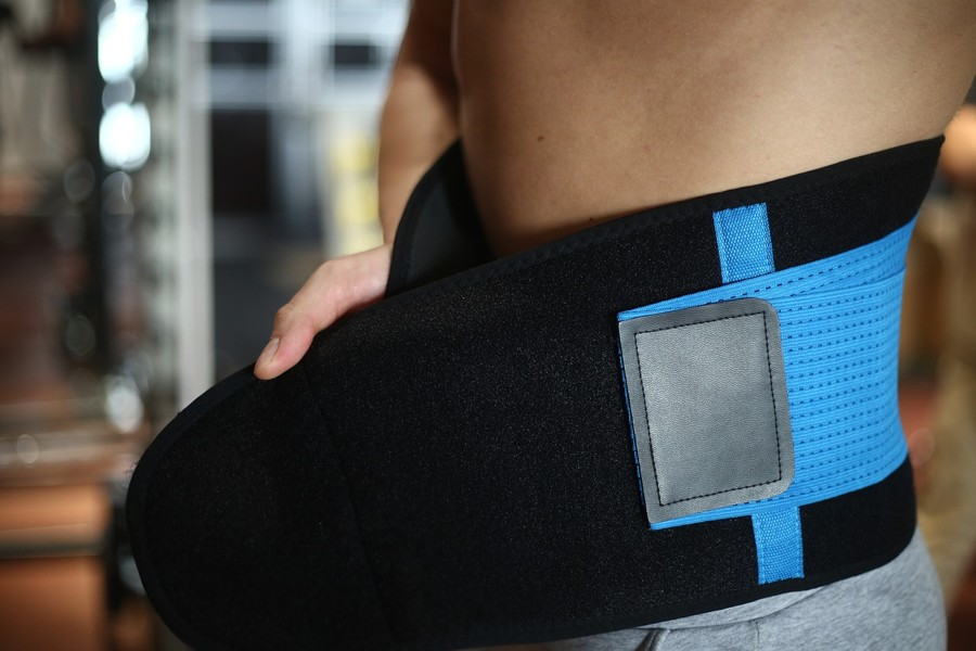 man with a waist trainer around his midsection