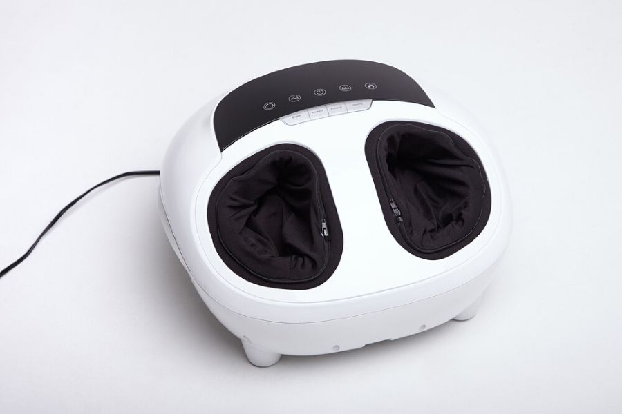 white foot and calf massager on the floor