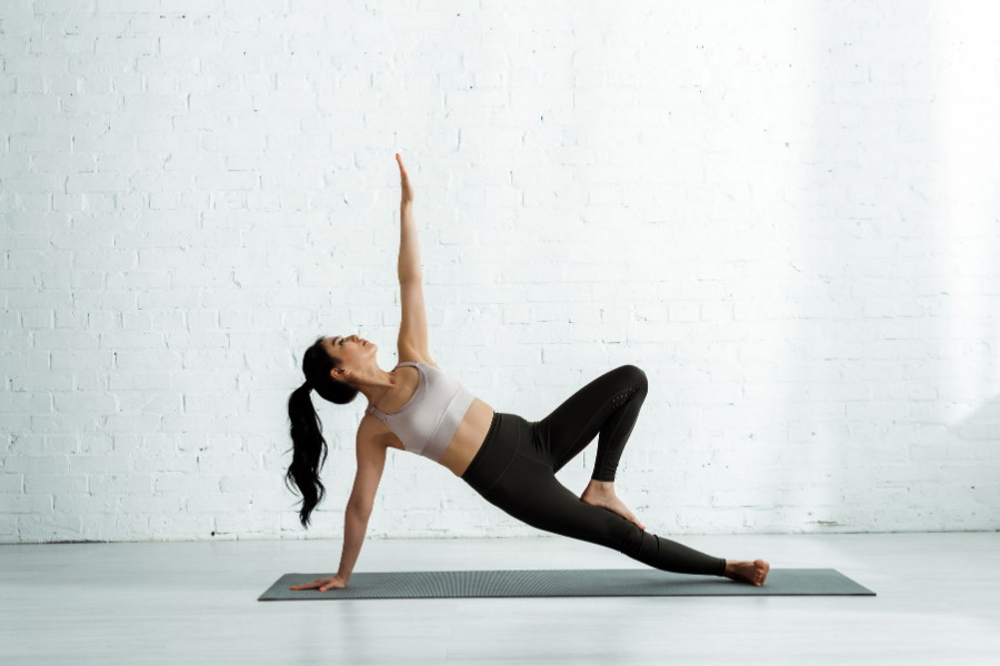 woman doing yoga in black yoga pants