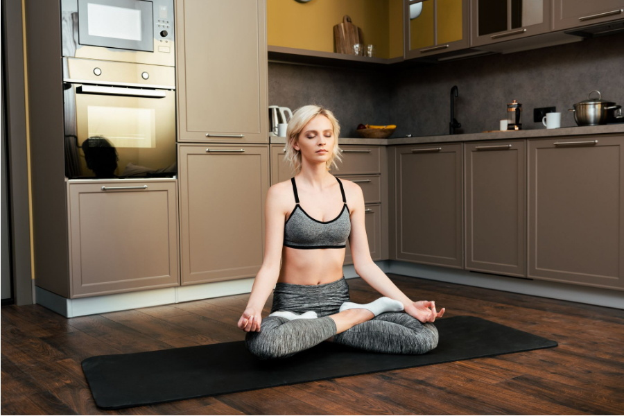 woman doing yoga in kitchen