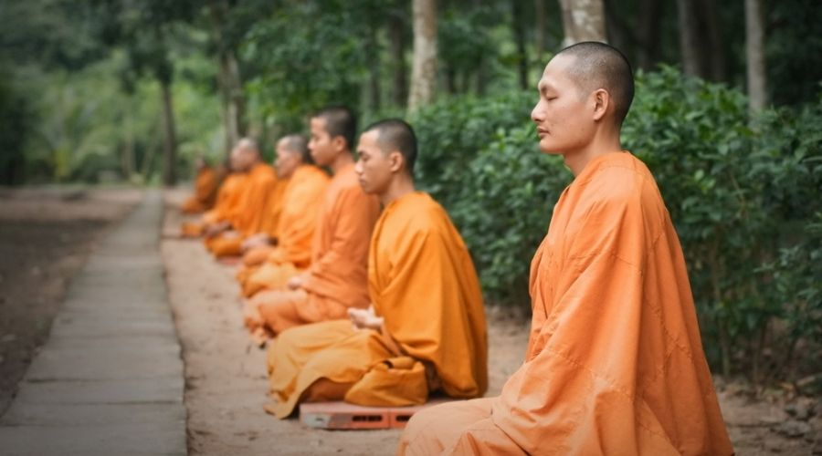 monks meditating on the side of the road