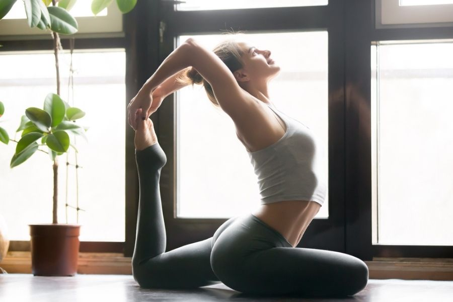 young woman doing ashtanga yoga pose