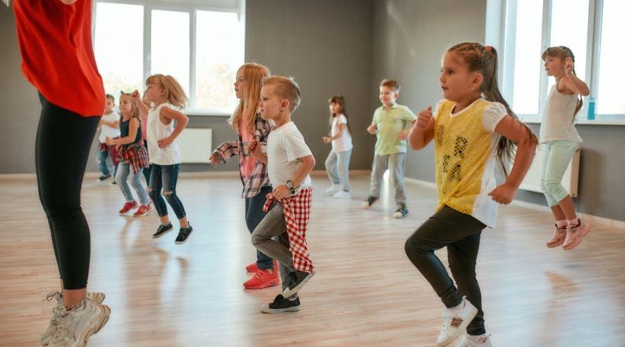 kids dancing before a yoga class