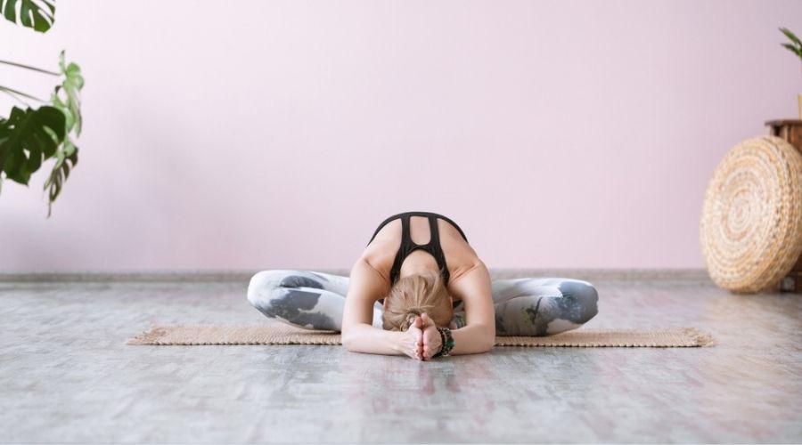 woman doing butterfly pose yin yoga