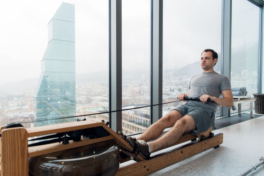 WaterRower review - man in apartment building using the WaterRower
