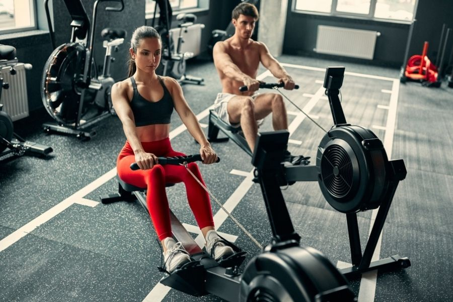 a couple doing rowing machine workout