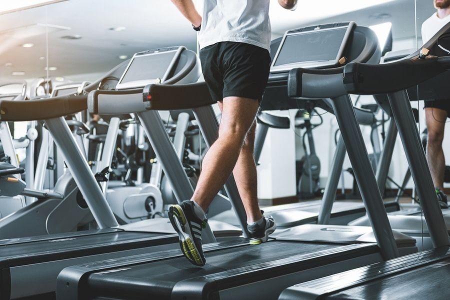 a man on a treadmill in the gym