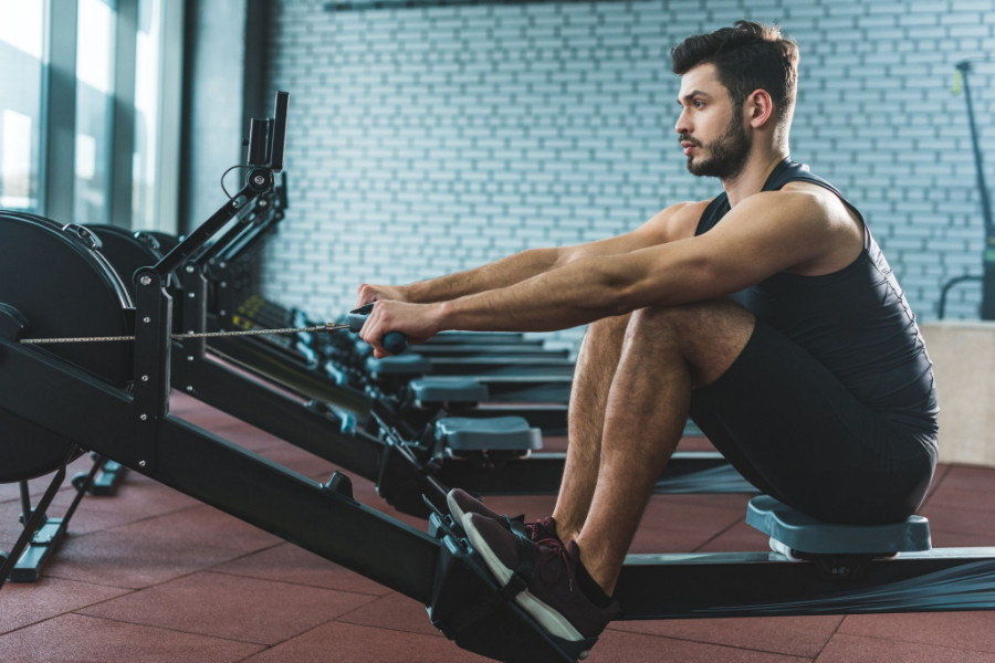 how to use a rowing machine - man on rower