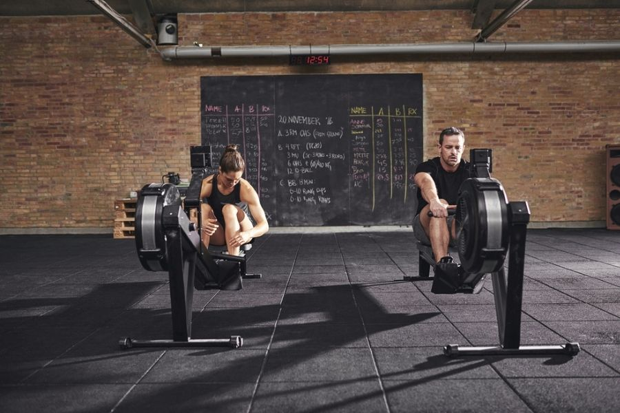 man and woman rowing on the concept2 rower