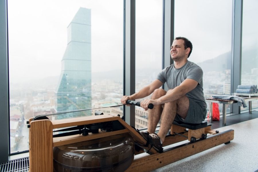 man on water rower