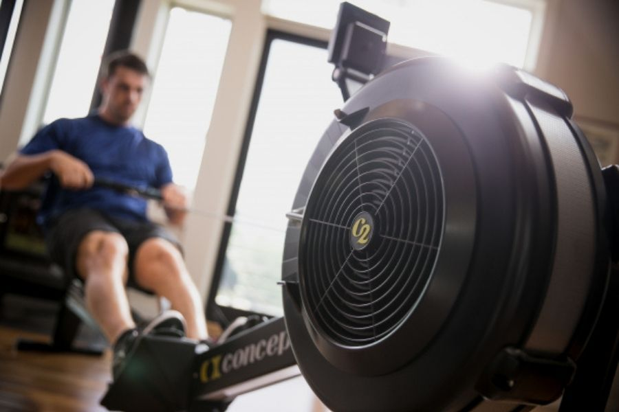 man rowing on concept2 doing the 4x4 workout