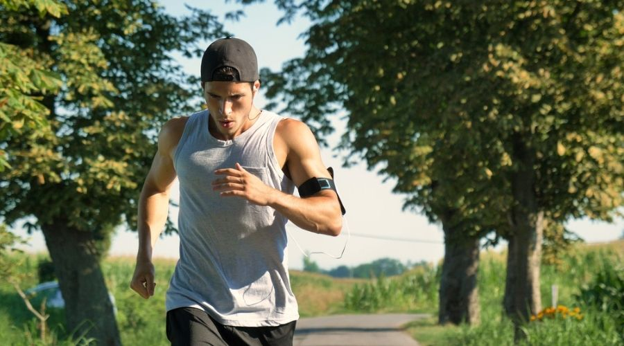 man running outside with calorie tracker