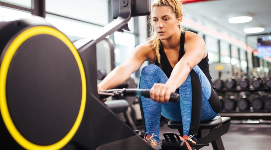 woman rowing doing workout