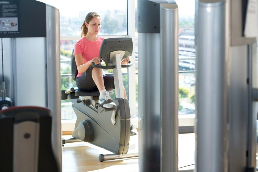 woman on a recumbent bike in the gym