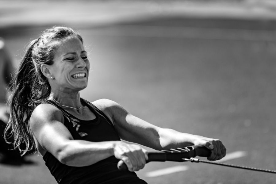 woman working out hard on rowing machine