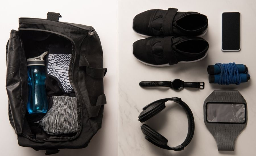 open gym bag with gym essentials to the side
