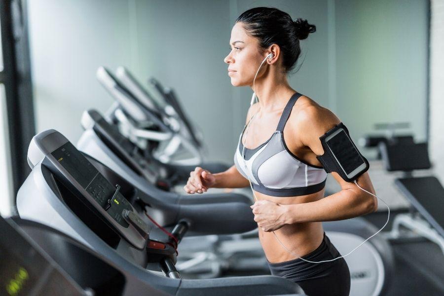 a woman running on a threadmill
