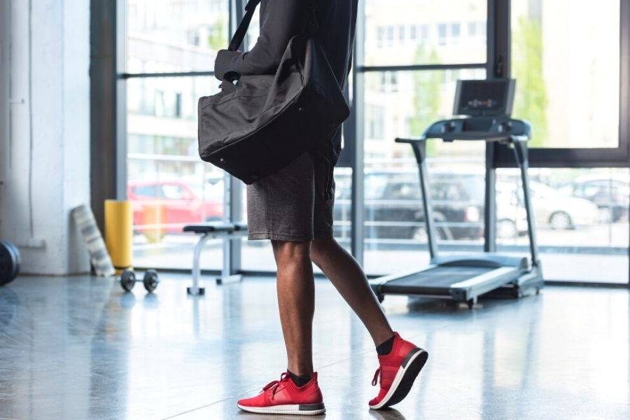 crocropped image of a man carrying a gym bagpped image of a man carrying a gym bag