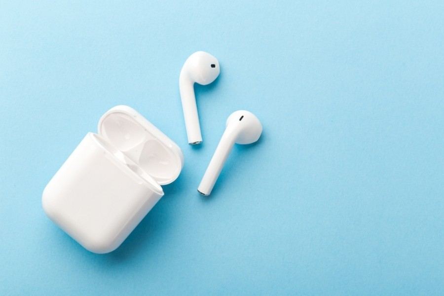iPhone headphones on a blue background