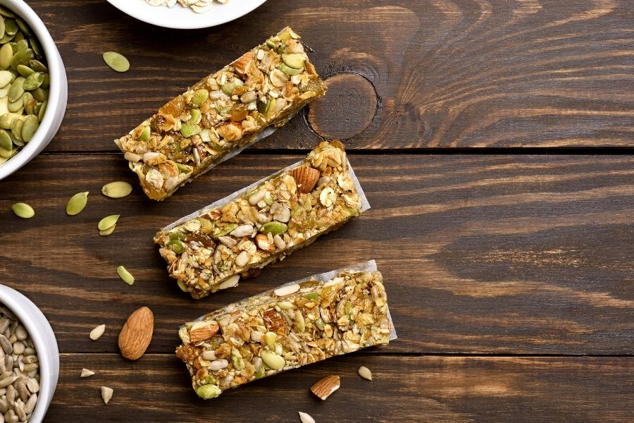 three protein bars on wooden table
